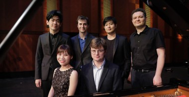The finalists are (from back left): Daniel Hsu of the United States, Kenneth Broberg of the United States, Yehwon Sunwoo from South Korea, Yury Favorin from Russia, Rachel Cheung from Hong Kong and Georgy Tchaidze from Russia. They were announced at The Fifteenth Van Cliburn International Piano Competition held at Bass Performance Hall in Fort Worth, Texas. / Photo by Ralph Lauer